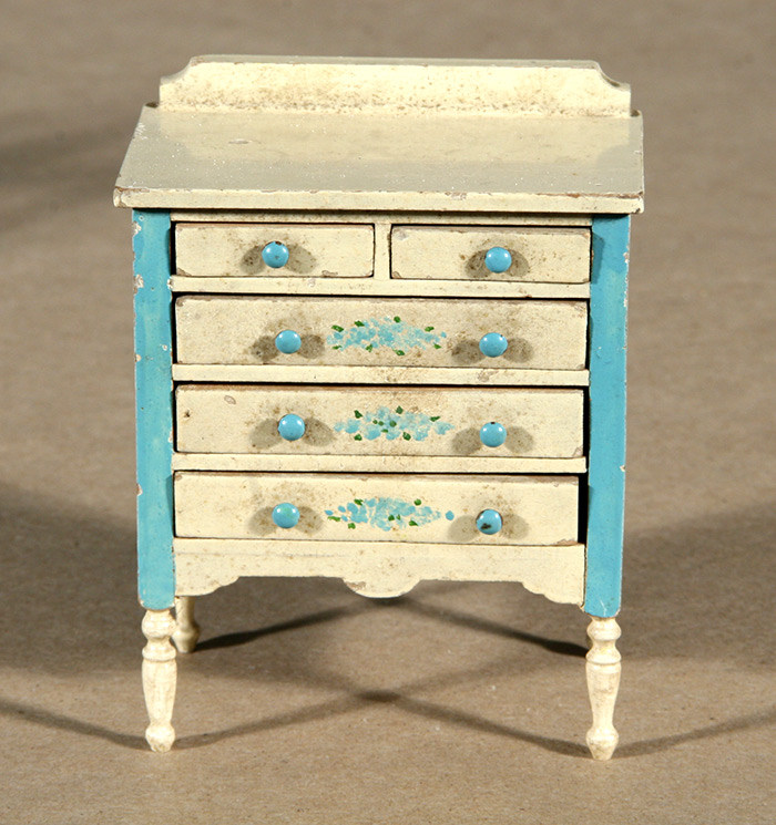 Photo:  Historic dollhouse painted dresser after restoration
