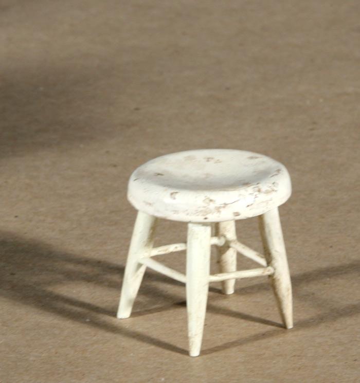 Photo:  Historic dollhouse miniature stool after repair