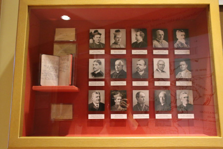 """Photo:  One of the Shrine's display cabinets fabricated at Bernacki & Associates, Inc. The display features Mother Cabrini's """"business cards,"""" her """"address book,"""" and the photographs of individuals listed by Mother Cabrini among her contacts."""