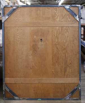 Metal frame fabricated and fitted around panel to prevent any future warping movement