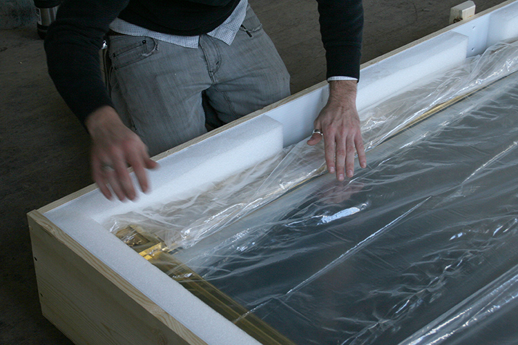 Wrapping the conserved giltwood framed mirror placed in a professionally designed custom crate with appropriate padding cavity