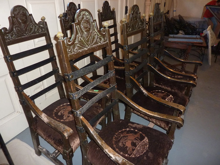 A set of 6 chairs recovered from muddy water. The chairs are composed of carved wood, leather straps, and upholstery with etched velvet fabric