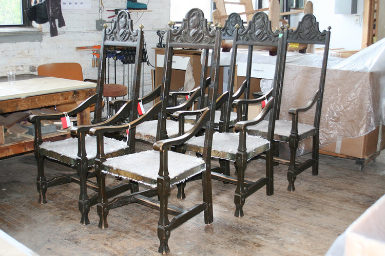After removal of wet upholstery, the chair's wood frames were slowly dried to minimize the shrinkage damage.