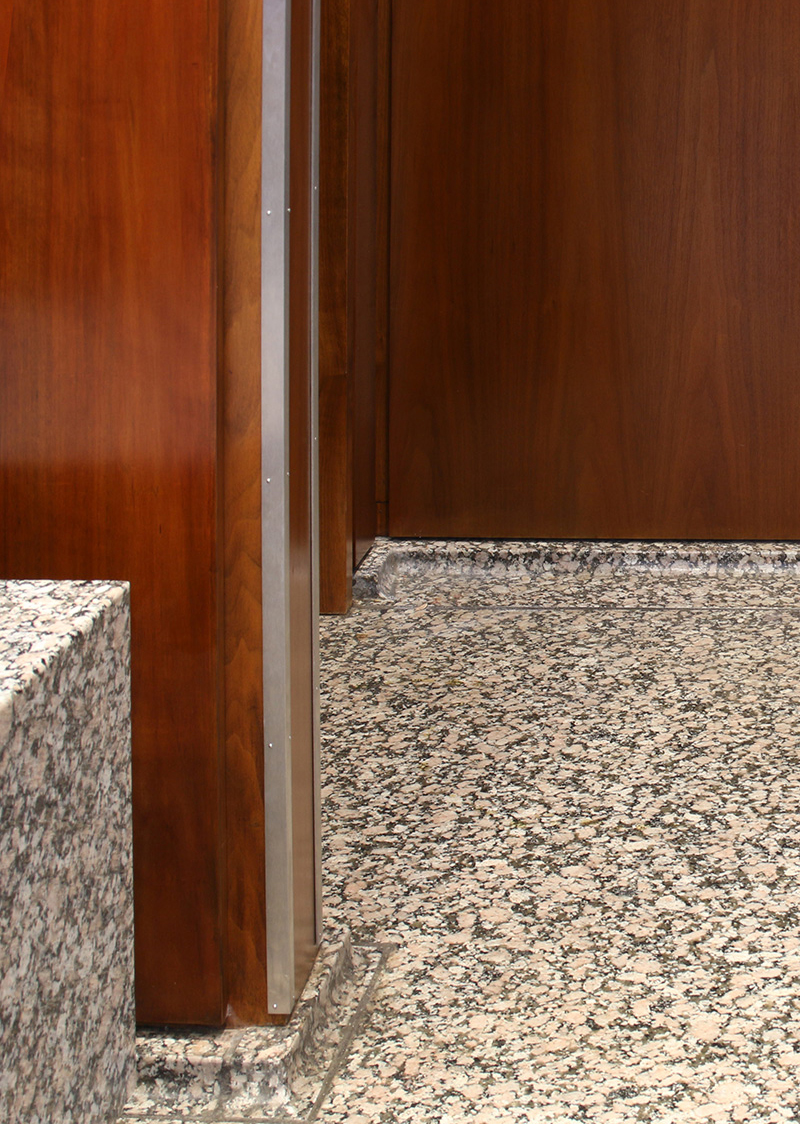 Restored panels and trims; granite bench and metal corner guards installed for protection | Photo courtesy of GSA