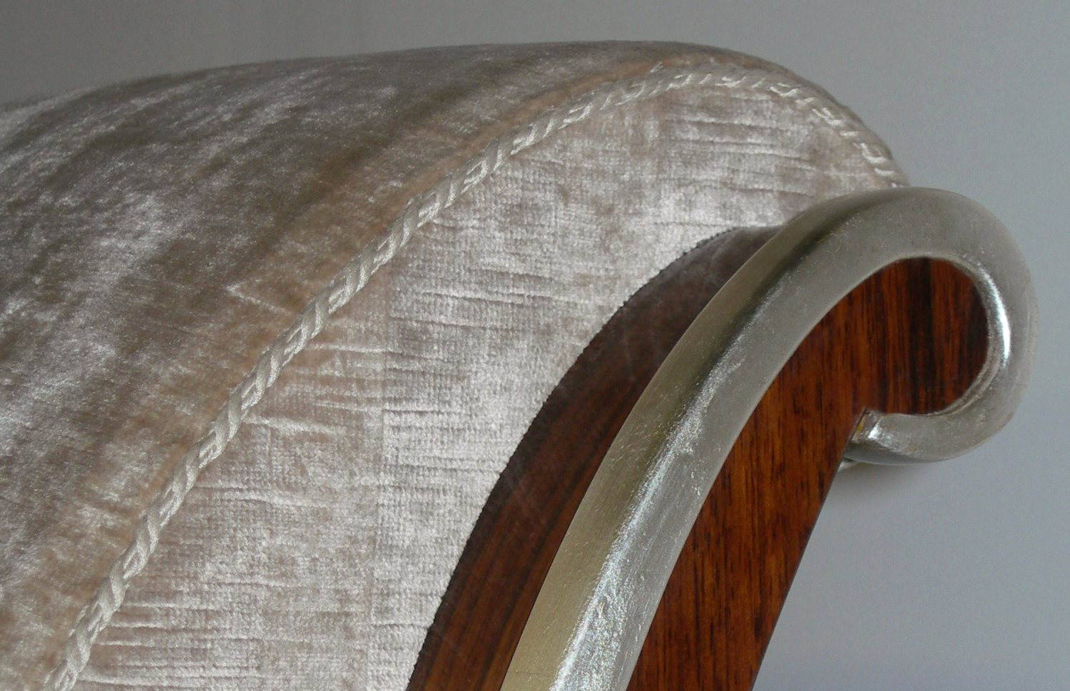 Detail of headboard upholstery, rosewood, and gilded trim