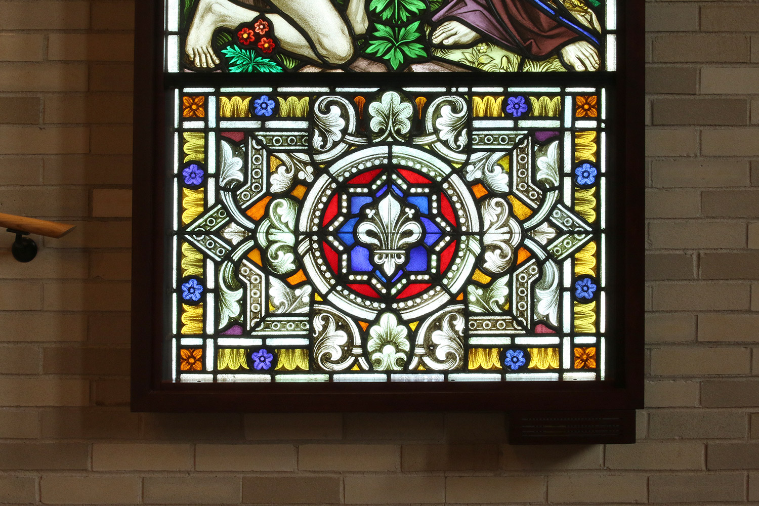 Stained glass window and hosting frame detail.