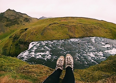 Taking in the view after hiking to the top of the Skogafoss waterfall.