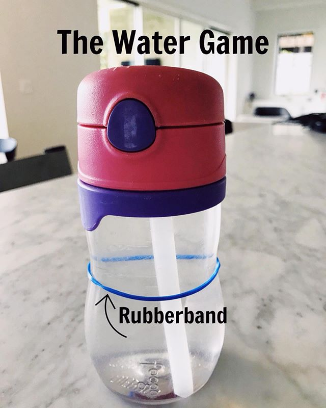 "The Water Game: My kids were home sick 🤒 for 2 weeks and hydration became a real struggle. I am on a mission to starting off our mornings hydrated and setting that tone for the rest of their days at school. . . To teach this game simply push the rubber band down each time your LO drinks and playfully say ""Do you think you can drink down to the rubberband?"" It is such a great visual prompt and my 5 year old thinks it's such a fun competition (with herself 🤣) to drink up to the line. It's become part of our routine now that a rubberband goes to school with her water bottle every morning and guess what? It works like a charm 😉 .  My 2.5 year old doesn't quite understand but will down water when she sees us doing it 🤣 Just watch my stories but I'm sure she'll get it in no time. Summers coming... let's keep them hydrated 💪"