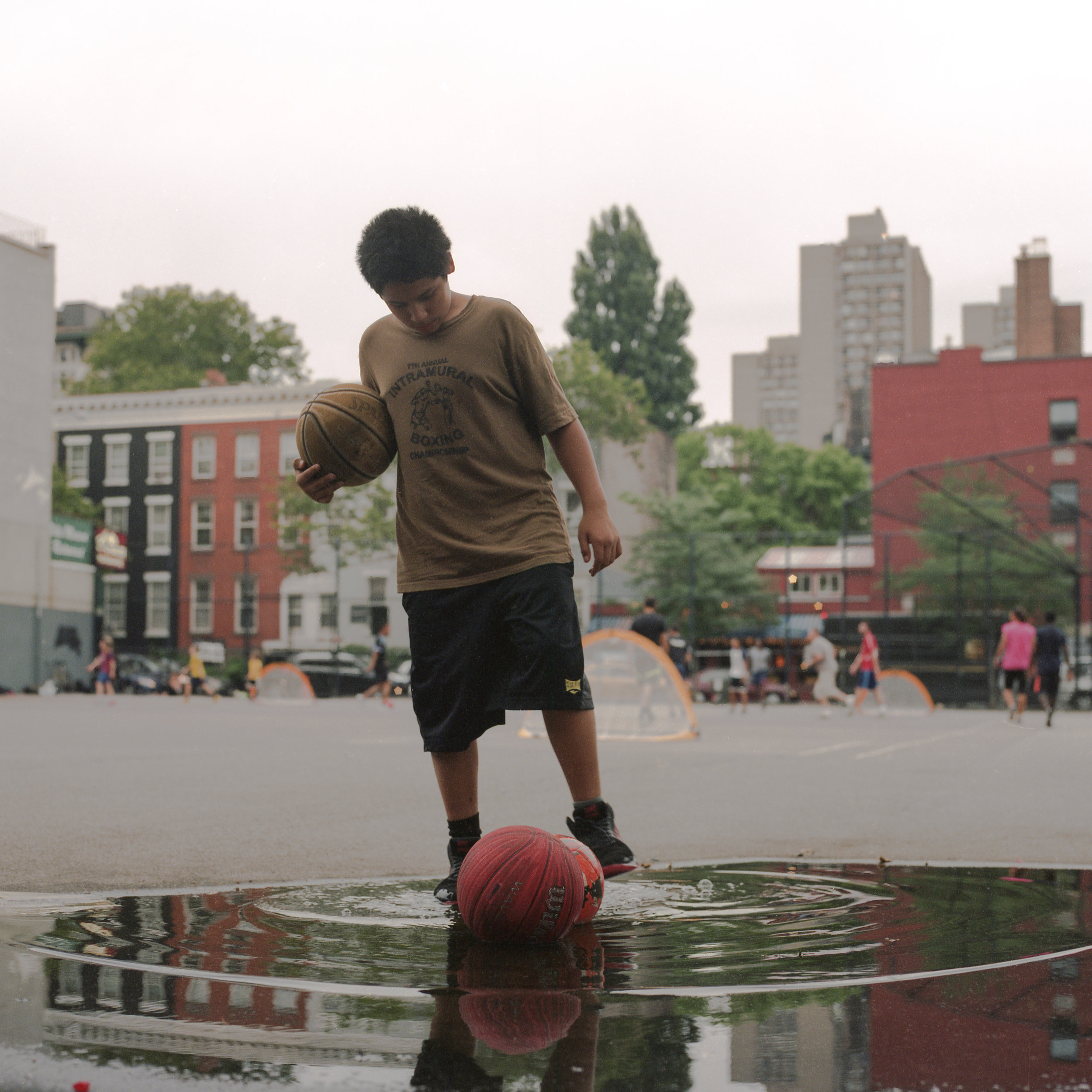 A boy with basket balls