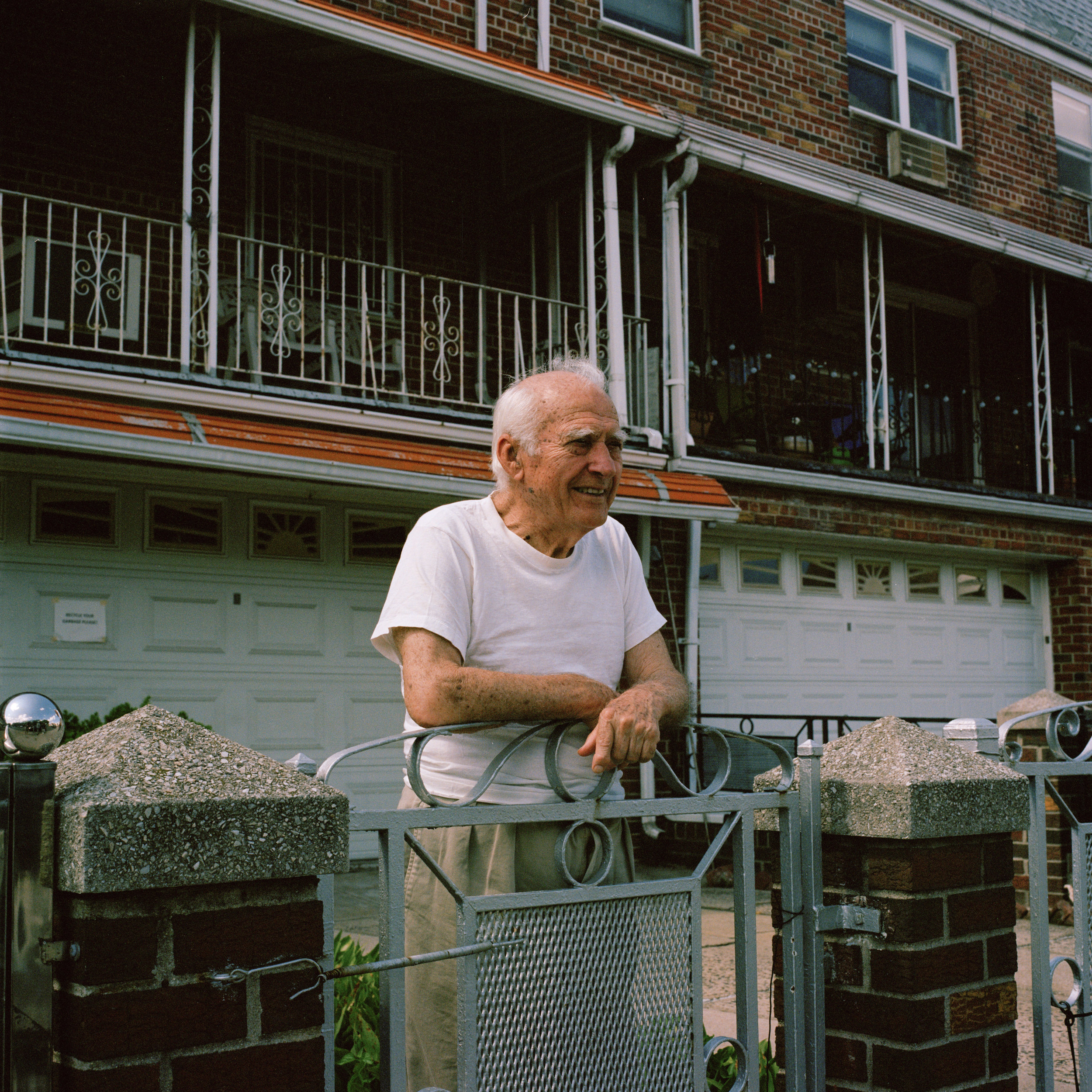 A man standing in front of his house
