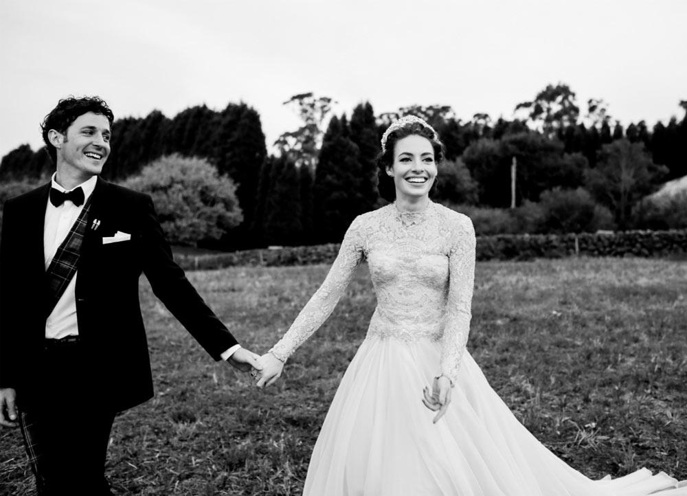 Hopewood-House---Weddings---Emma-&-Lachy---Wiggle-Wedding---Shot-19---Couple-open-Field.jpg
