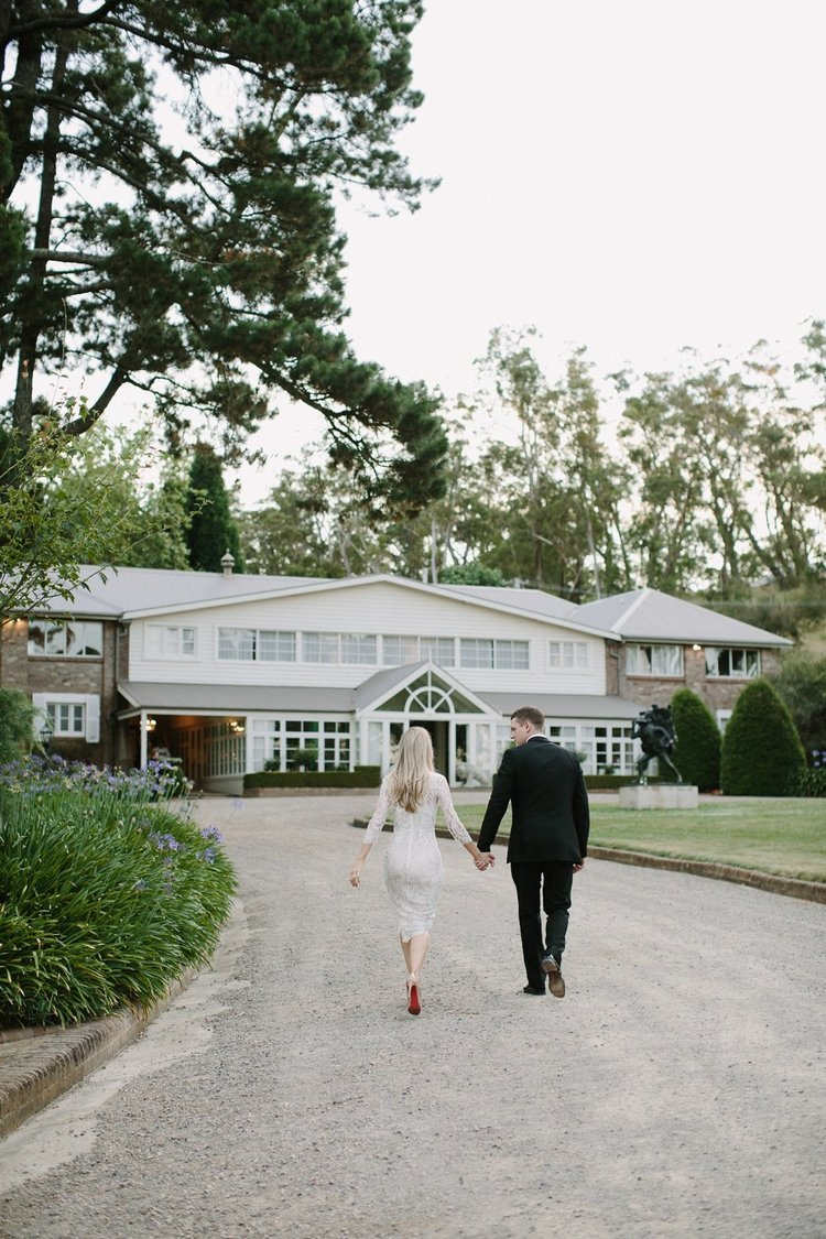 Hopewood House - Wedding Day Gallery - Heart and Colour Photography - Candice and Adam - Couple Walking past Autins Lawn and the Wayfarer on the way to the Pavilion.jpeg