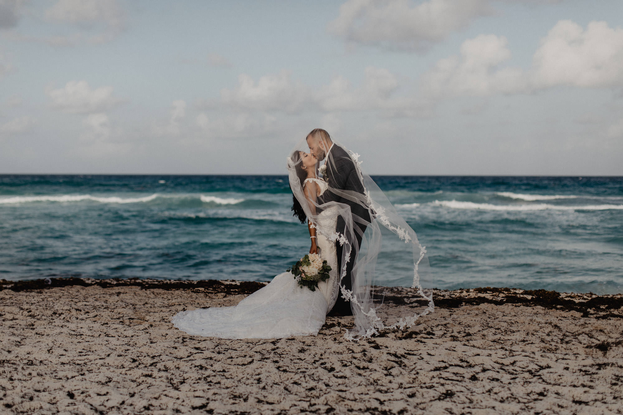 bride and groom beachside wedding portraits in Cancun Mexico