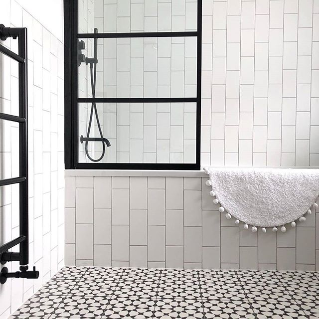 A little monochrome magic and bathroom inspiration from @style_my_family_home. We love how balanced this design is, and the unconventional tile placement is 👌 . . . #mymonochromehome  #stylemyfamilyhome  #bathroomsofinsta  #bathroomgoals #modernbathrooms #bathroomreno  #bathroomrenovation  #monochromebathroom #ihavethisthingwithfloors  #ihavethisthingwithtiles #monochrome  #tileinspo  #revamprestylereveal  #ekbbhome  #livingetc #howmonochrome  #designmilk #myhousebeautiful