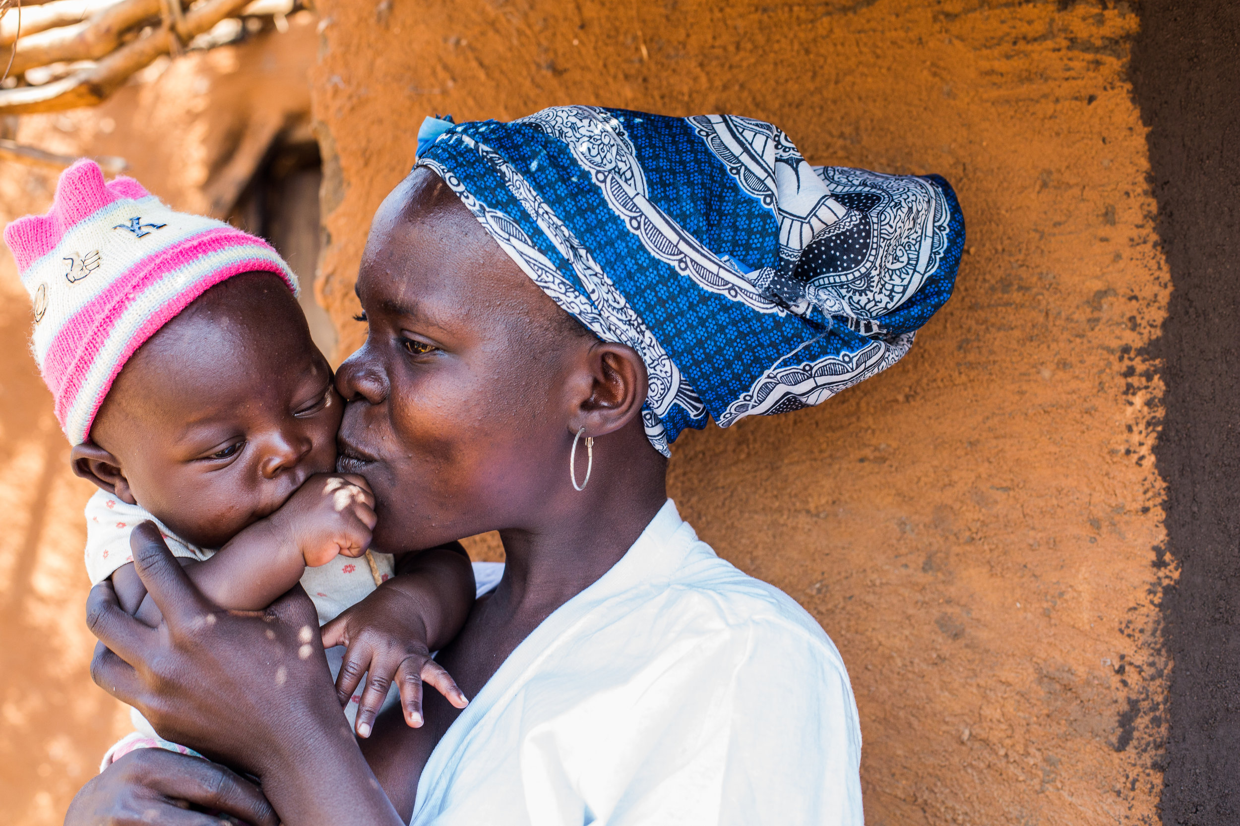 A mother kisses her baby daughter in Malawi (Photo: Corrie Wingate)