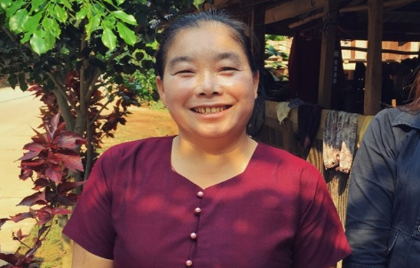 Yu Wan, a grandmother and Community Health Volunteer, smiling in Myanmar
