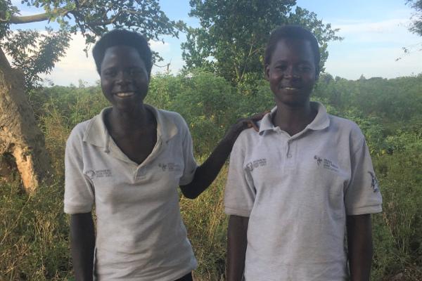 Women's health group leaders pose near their community meeting in Oyam, Northern Uganda