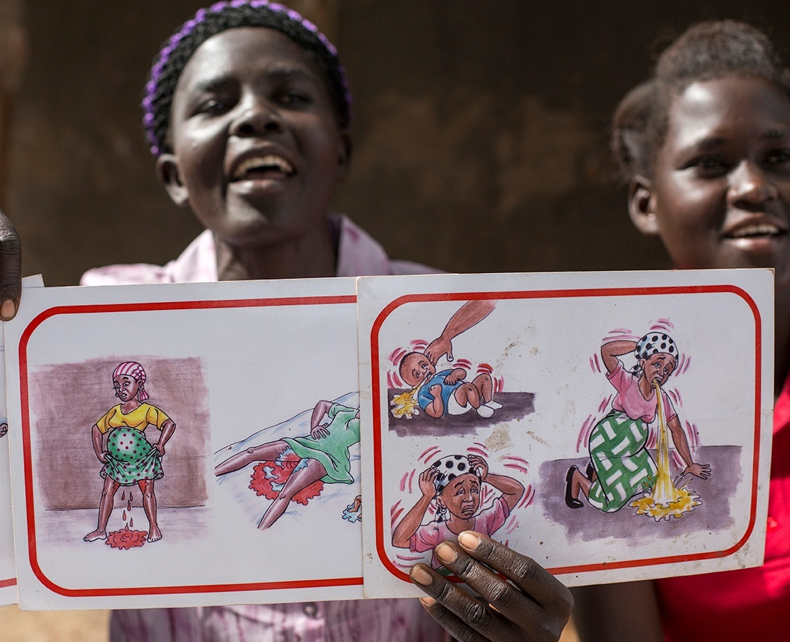 Nighty using picture cards to show problems that women could face in pregnancy or childbirth.