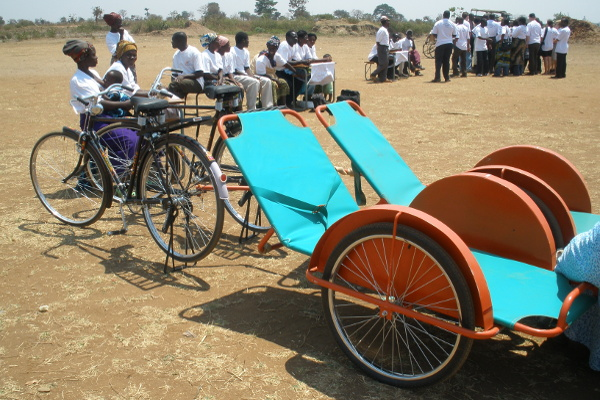 Two bicycle ambulances in a village in Malawi are ready to transport pregnant women in labour to their local health facility