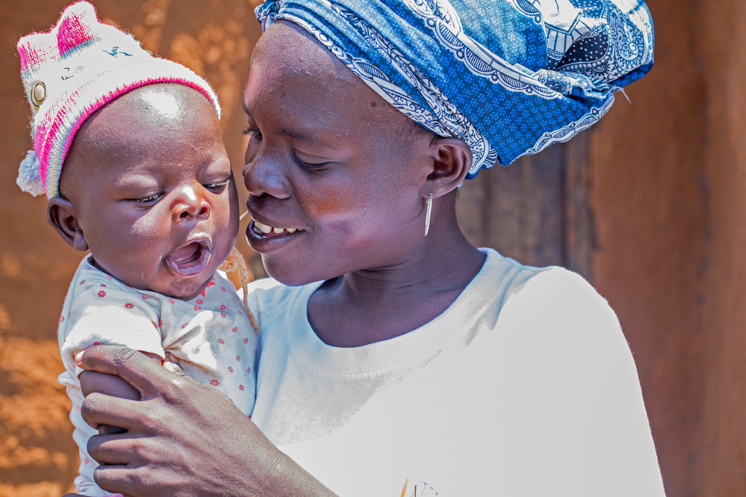 A women's group member with her young baby in Salima District, Malawi (Photo by Corrie Wingate)