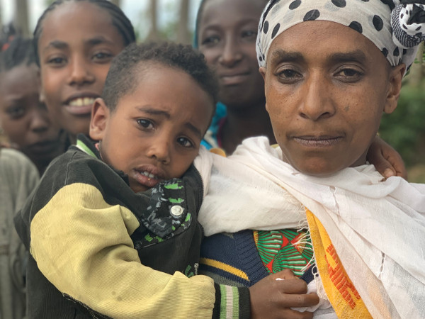 Birtukan holds her son, who suffered from diarrhoea, before receiving treatment