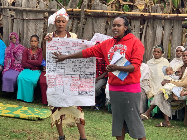 The women's health group comes together to discuss ways of overcoming maternal and newborn health problems