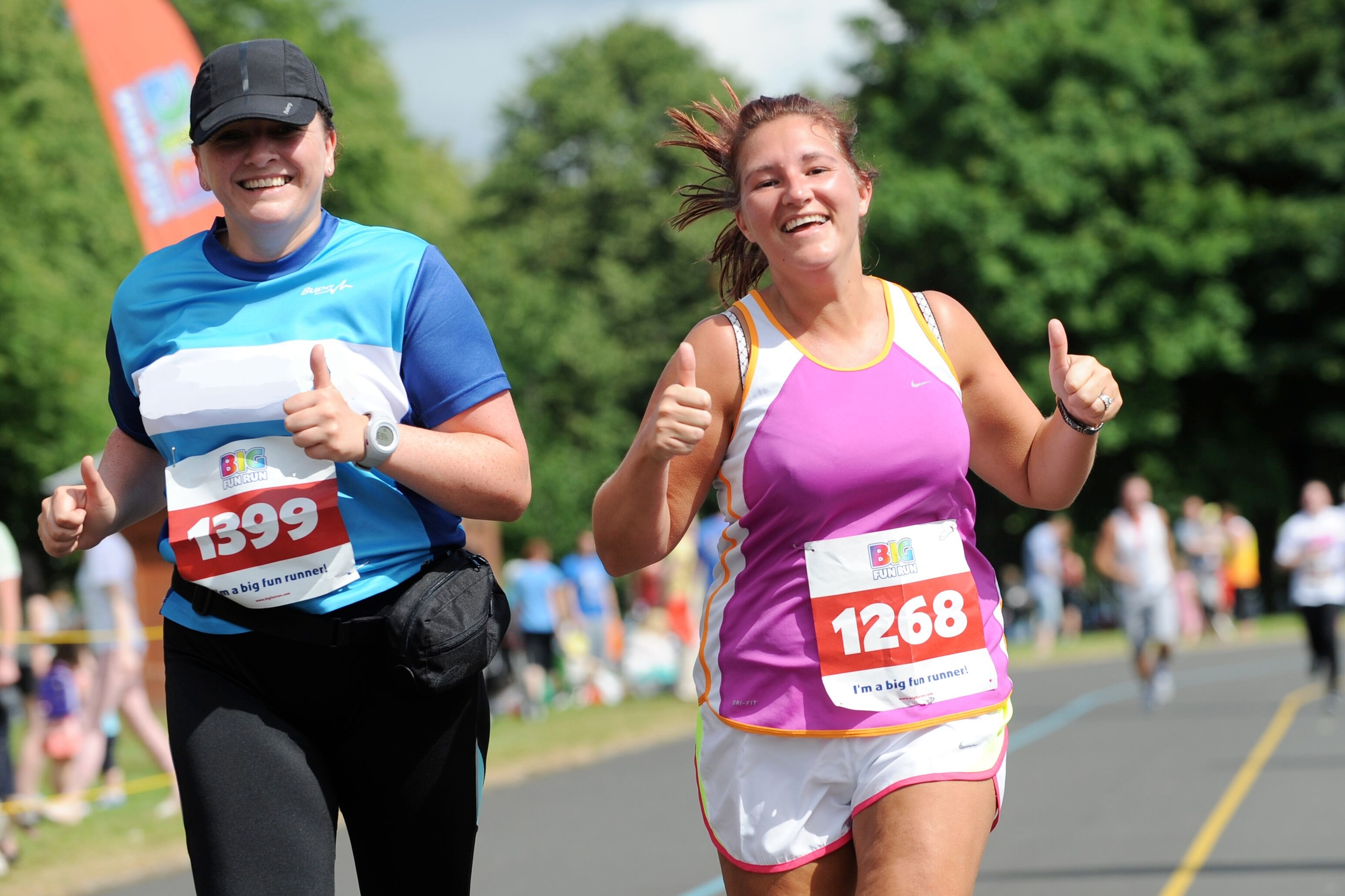 Two runners enjoy the Big Fun Run. Claim your free spot at the race - worth £15 - when running and fundraising at least £60 for Women and Children First.