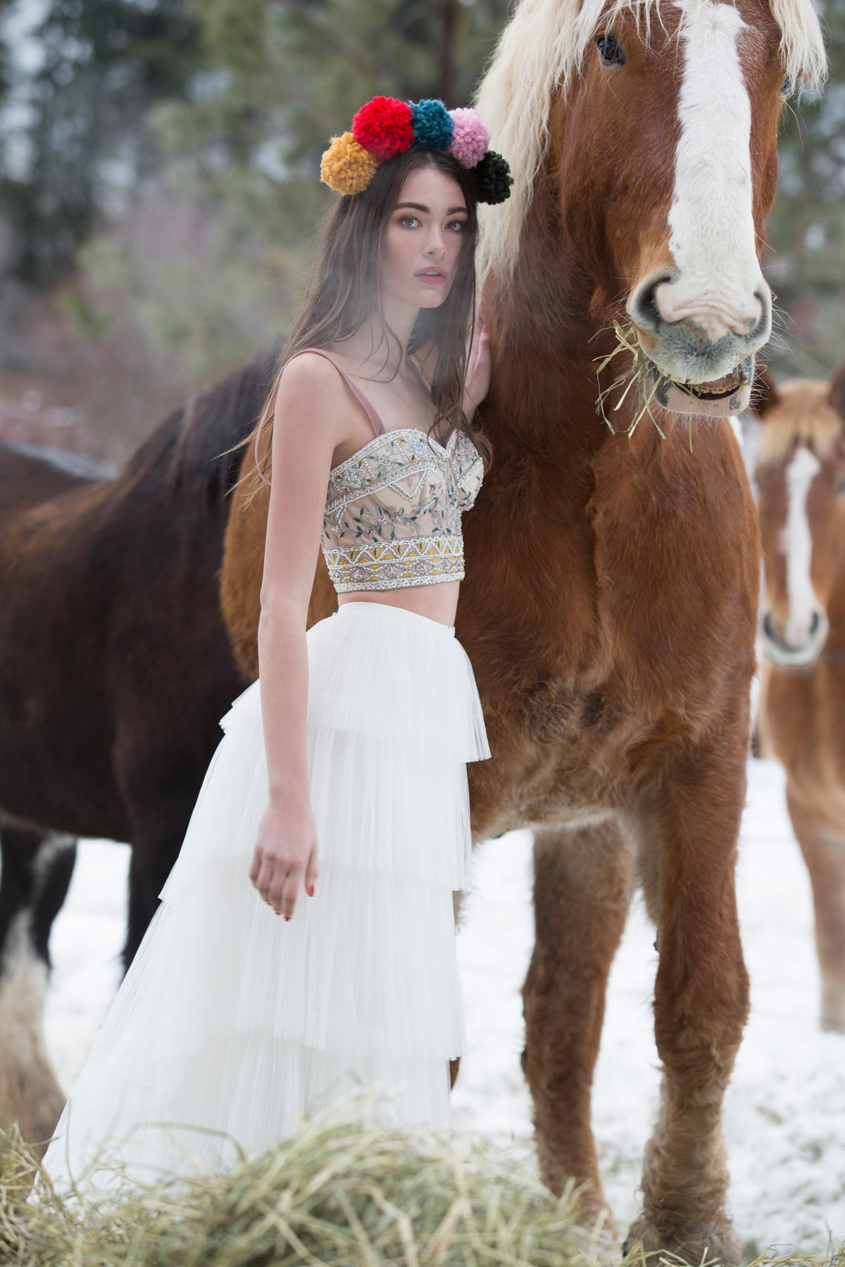 / 3 - WATTERS | POPPY BUSTIERVibrant, adventurous, and undeniably unique, this bustier features exquisite beading on dotted netting, tulle, and velvet ribbon straps. Wear it with our Chicory Skirt for a free-spirited look at your wedding.