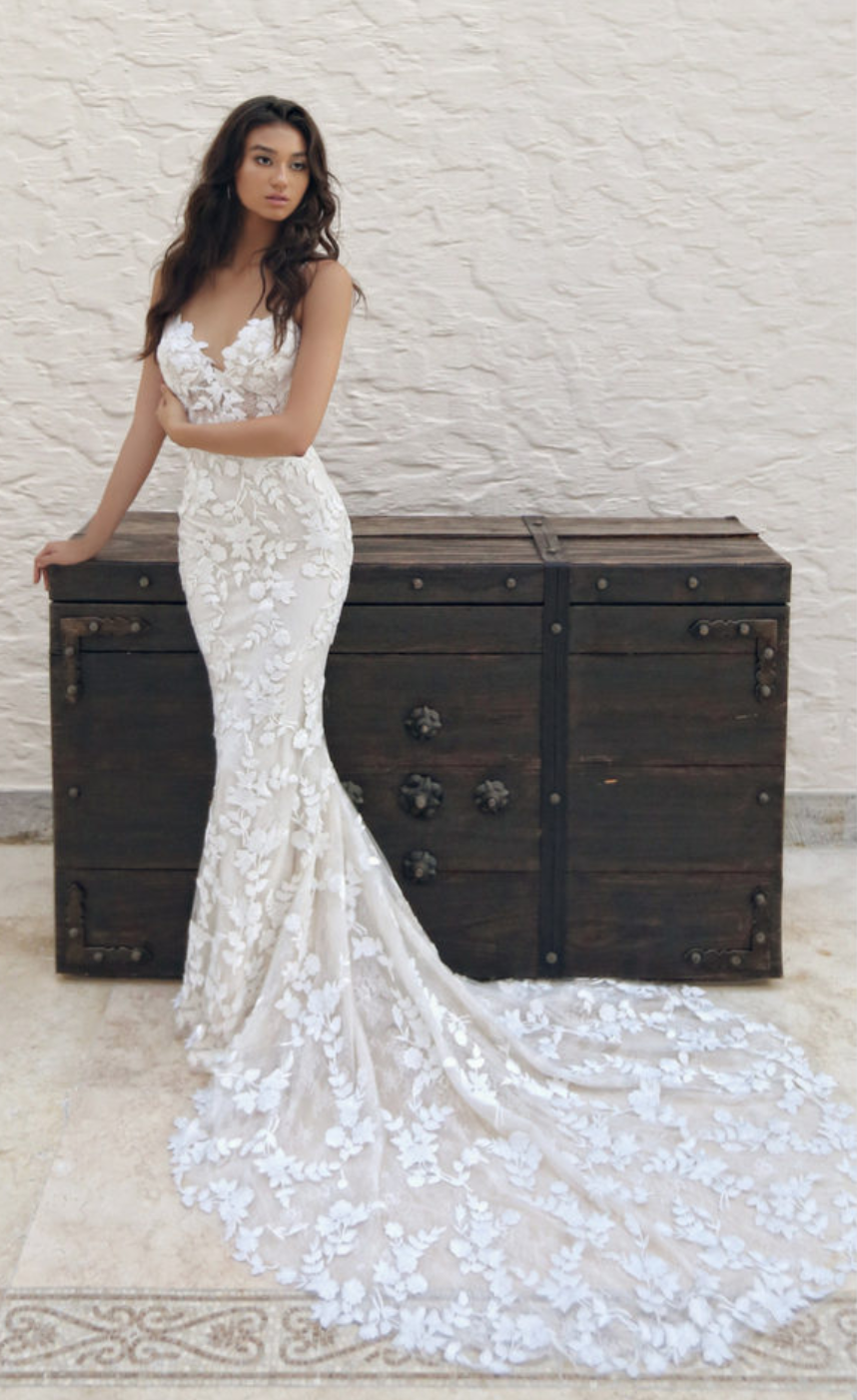 / 4 - ENZOANI | LESLEYStep straight out of a floral fairytale dream and onto the aisle in this sweet mermaid gown with delicate spaghetti straps framing the sexy, deep sweetheart neckline. Intricately embroidered lace appliques over the softest tulle, creating a romantic yet glamours look.