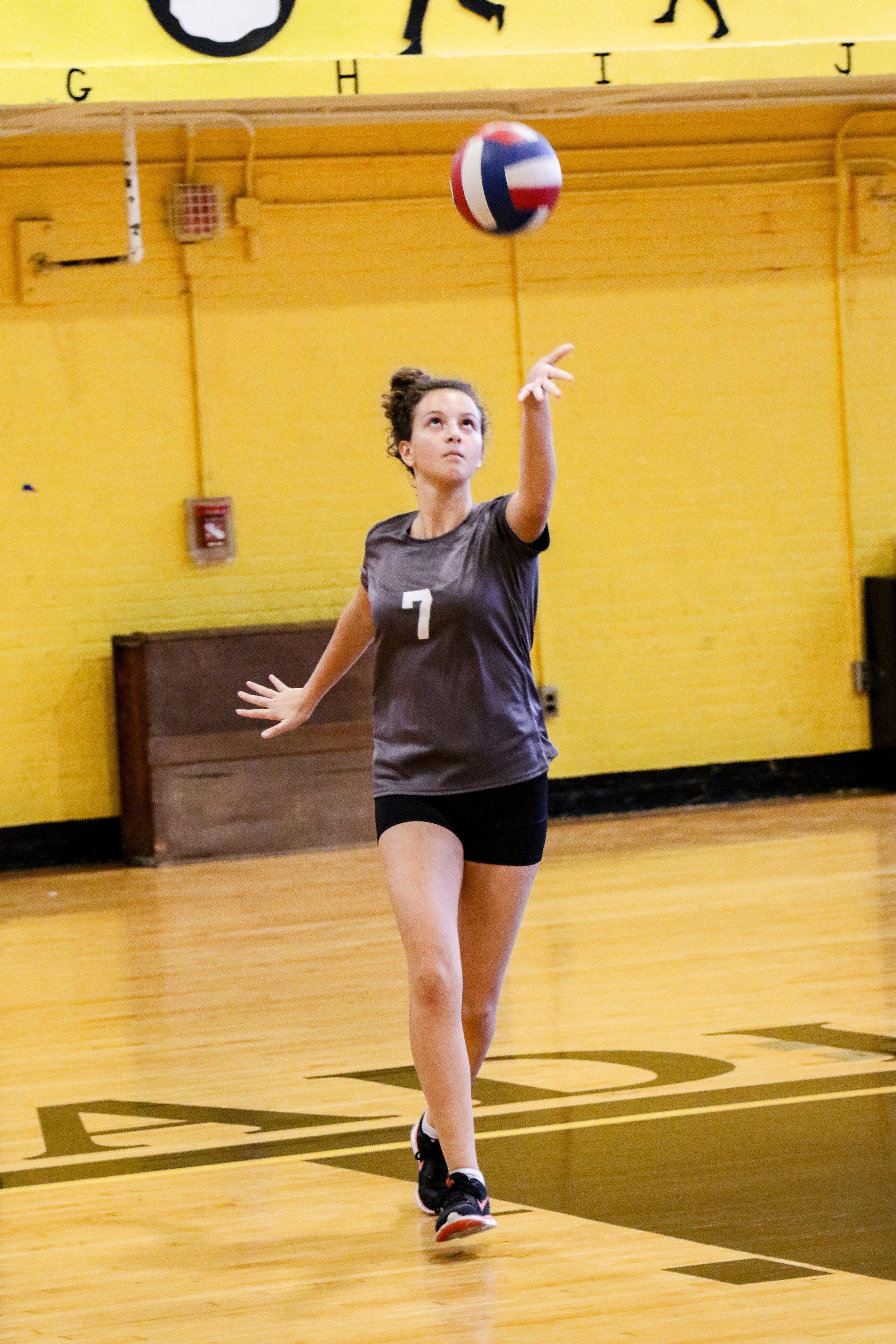Carelle Zak '21 serves against Lincoln High School.  Photo Credit: Continental Studios