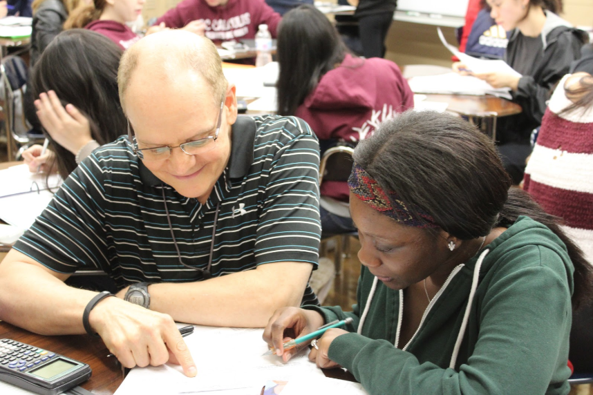 Mr. Caldwell works with a student.  Photo Credit: Sherry Chen