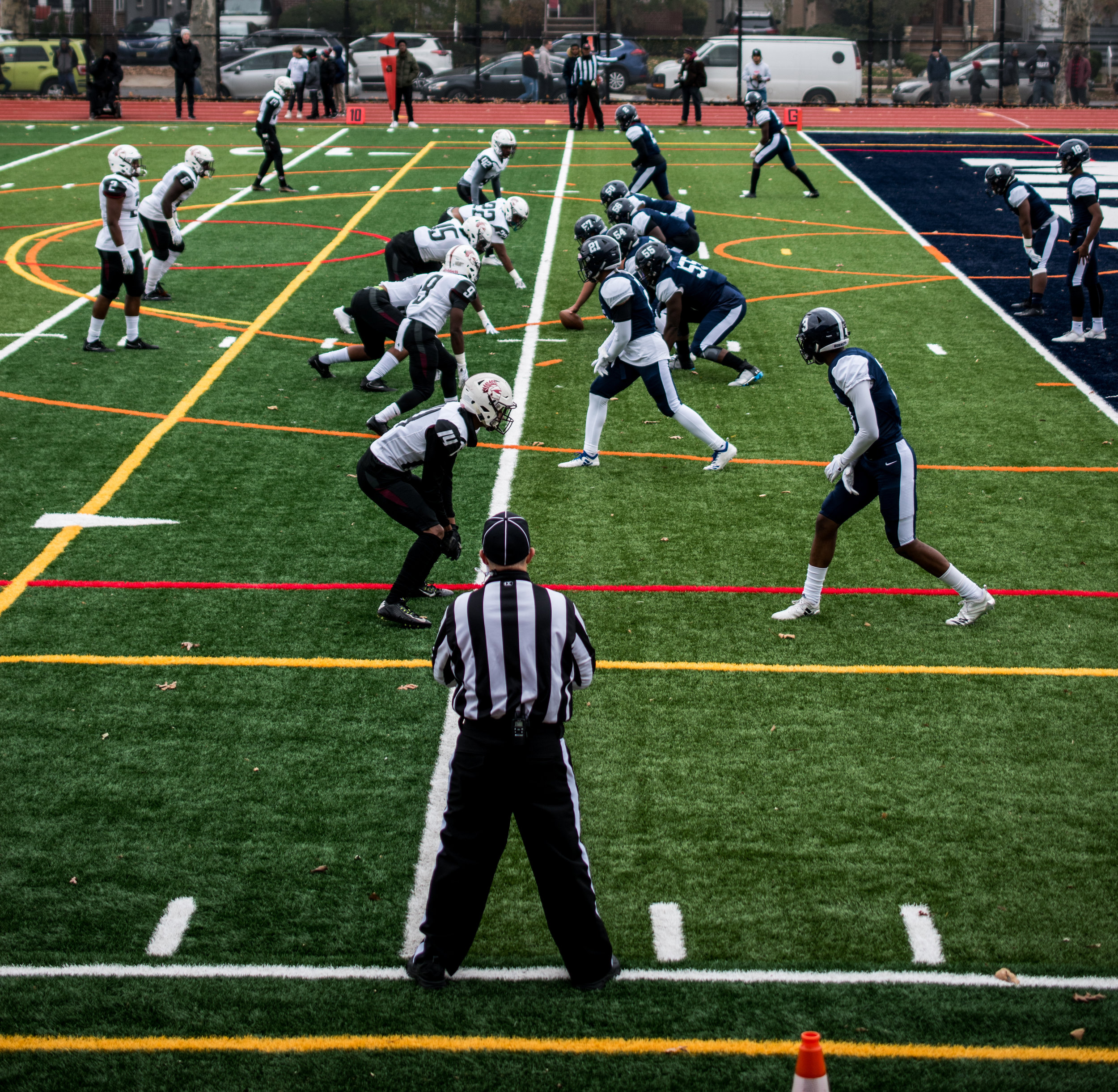 Boys Varsity Football lines up against Curtis High School.  The drive led to a Midwood touchdown.  Photo credit: Justin Chow