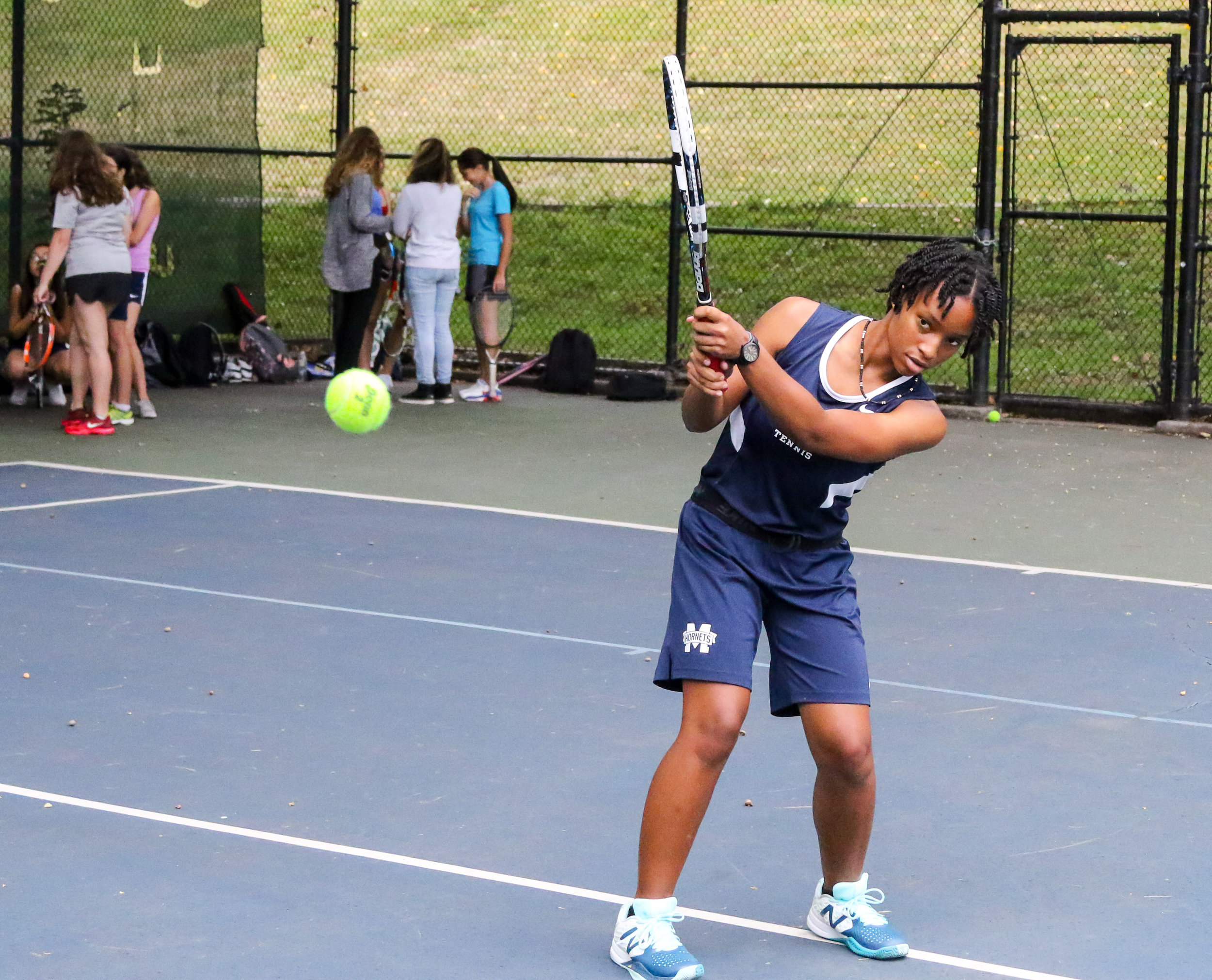Captain Soleil Robertson '19 perfects her backhand at practice.  Photo Credit: Coninental Studios