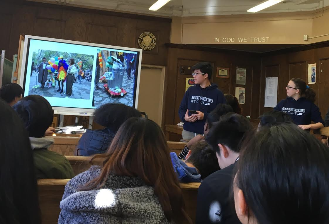 Victor Zheng '20 discusses the Fort Greene Great PUPkin Dog Costume Contest.  Photo Credit: Yesenia Peregrina