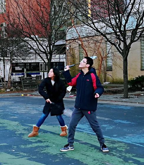 Badminton club members practice in the playground across from Midwood.   Photo Credit: PeiYu Jiang