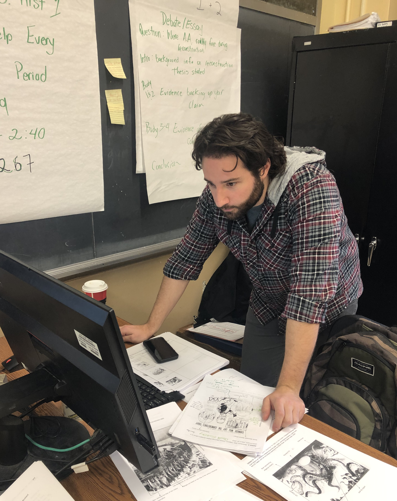 Mr. Livreri grades work for his U.S. History class.  Photo Credit: Shyanne Hinds