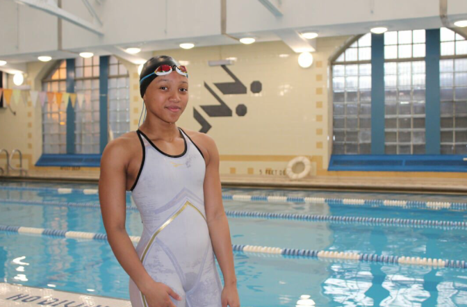 Kymora Corbett '20 suits up for a swim meet.  Photo Credit: Ashley Quarless