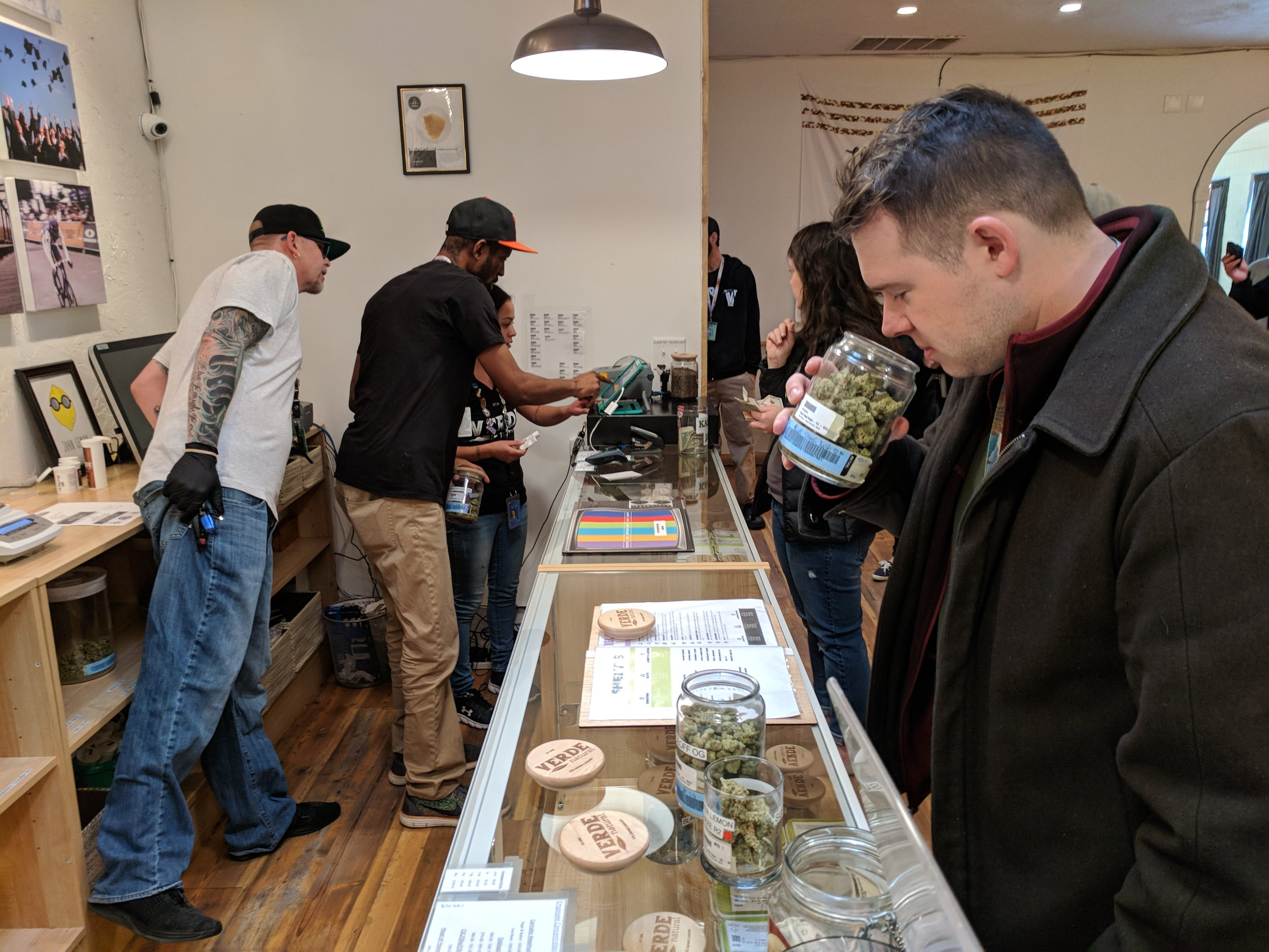 A cannabis tourist smells the marijuana product at a recreational dispensary in Denver, Colorado.   Photo Credit: My 420 Tours
