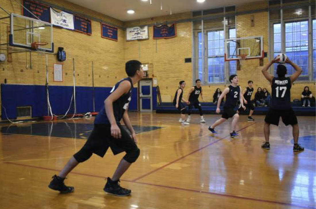 Outside hitter Zain Ali '19 approaches to spike the ball during practice.  Photo Credit: Yelyzaveta Yatsuk