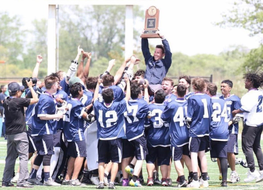 Last year's boys lacrosse team carries Mr. Alexander after winning the championship.  Photo credit: Emile Brammer