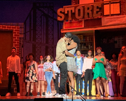 Benny (Asaru Wahls '19) and Nina (Anecia Henry '19) share a kiss, to cheers from the audience.  Photo Credit: Sharon Wong