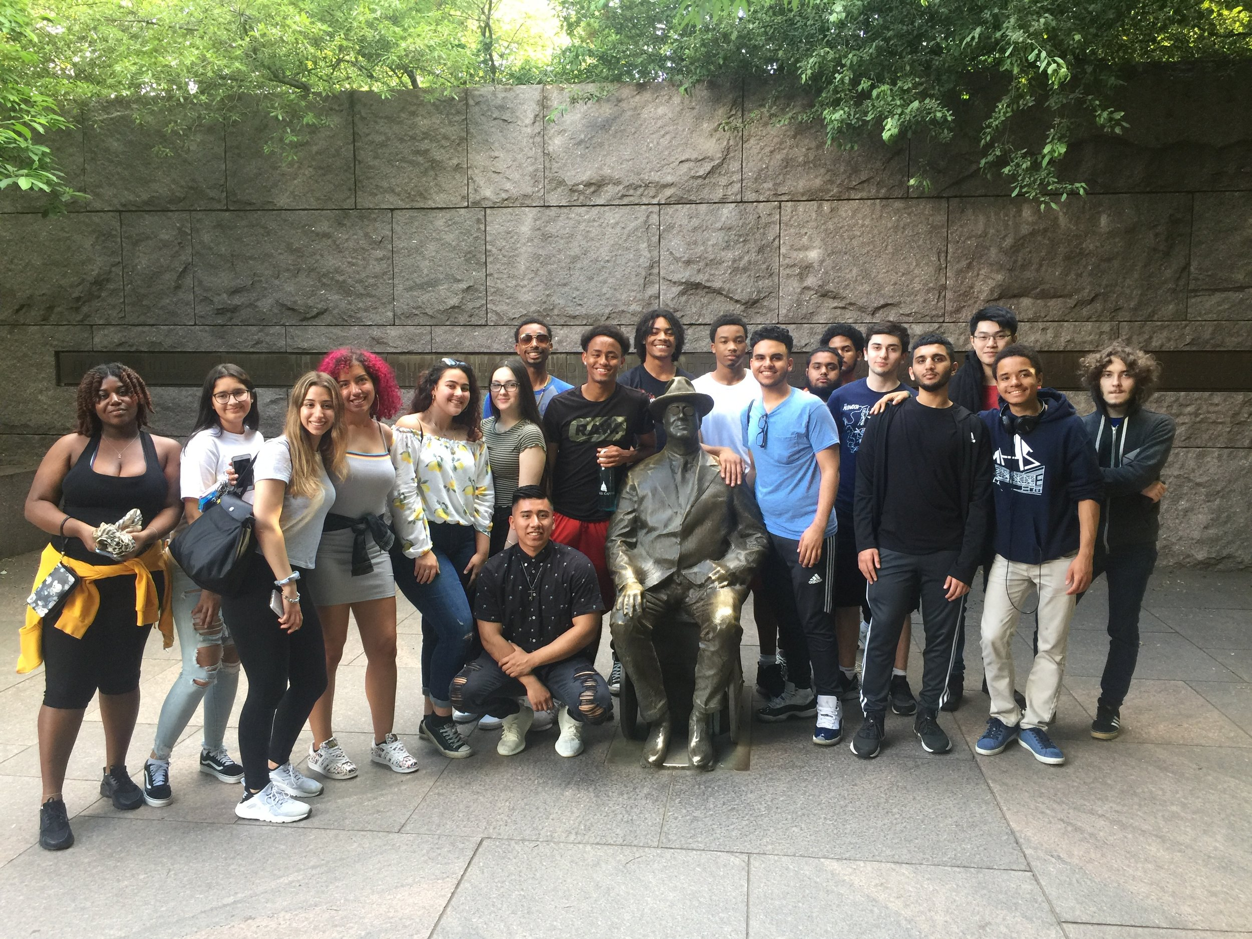 Students pose with a statue of Franklin Delano Roosevelt, who was elected four times as president despite being confined to a wheelchair.  Photo courtesy of Aaron Pimentel