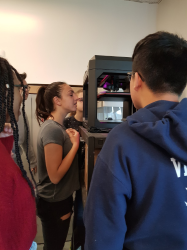 Students watch as Mr. Jahn 3D prints a chess piece.  Photo Credit: WanHua Rong
