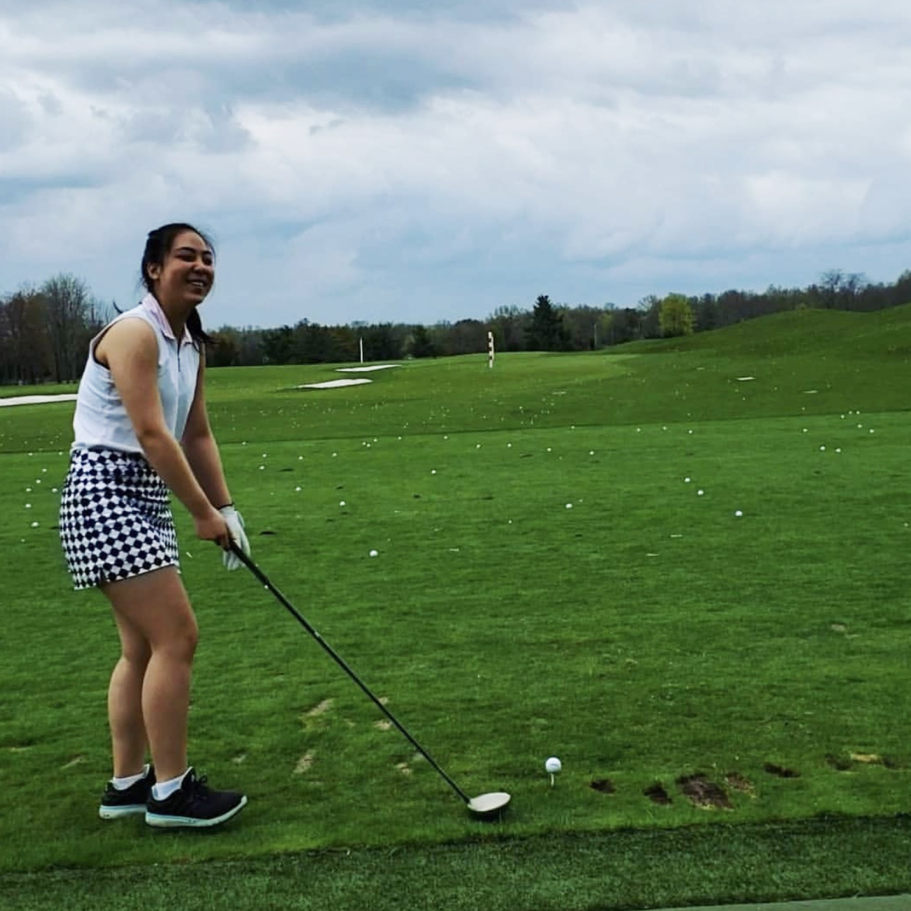 Alana Neria '20 gets ready to swing her golf club at Marine Park Golf Course.