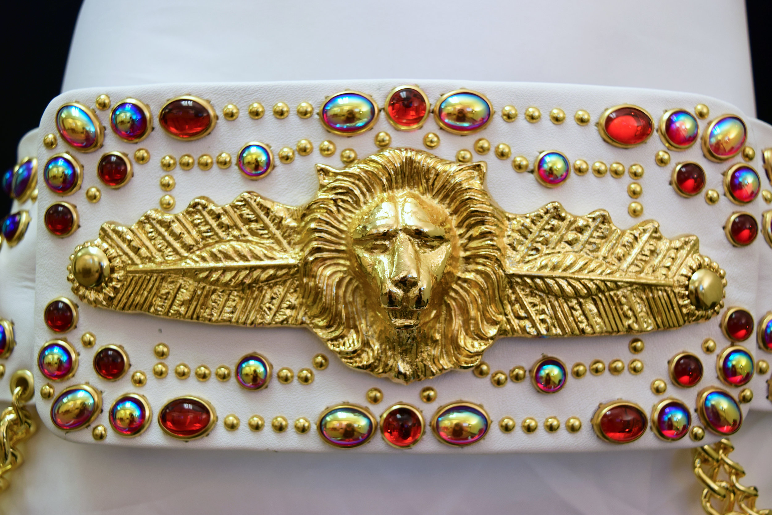 Lion and Feather Belt Red Buckle.jpg