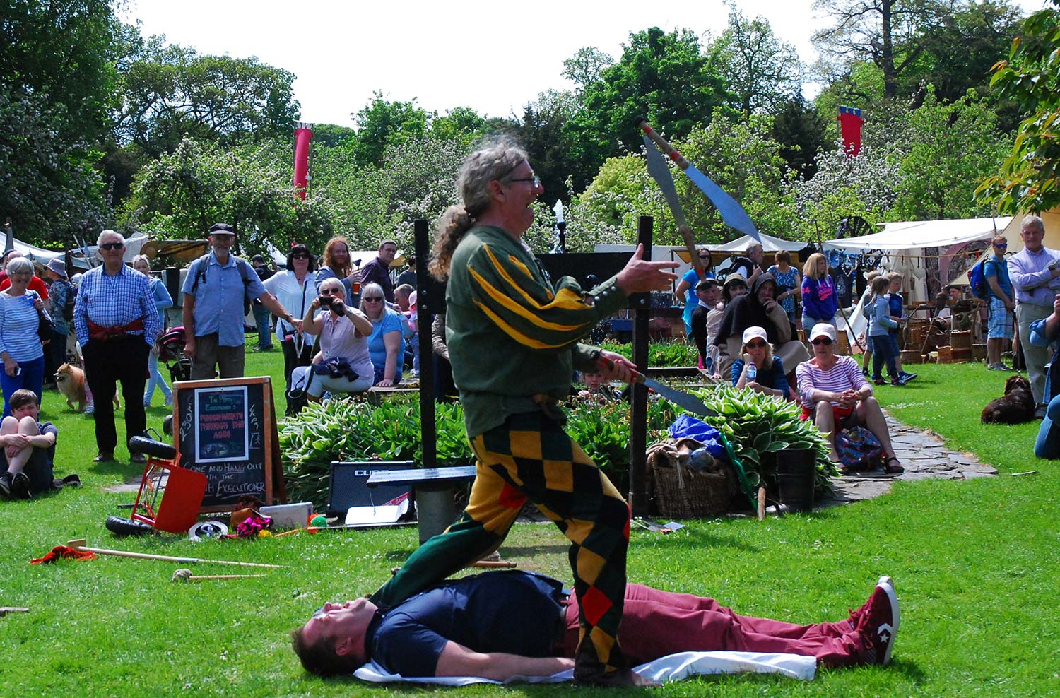 Visitors enjoy some extreme juggling at this year's Traquair Medieval Fayre