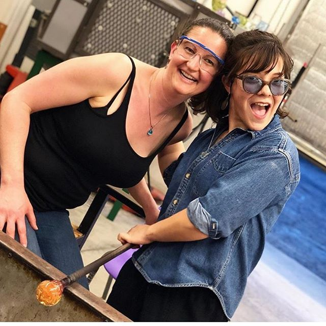 This could be YOU having a blast and learning all about glass! This coming Sat 11-6pm we are hosting a block party and will have demos and be open to the public!! Ornament classes running @ 12pm/2pm/4pm - click the link in our bio to find tickets! We can't wait to blow glass with you! 😘  Thank you @nicoleleffer for letting us use this fabulous image of you and our Shop Manager @dsimonec.works 💗🔥 #atlantahotglass #glassart #decatur #radblockparty #railartsdistrict #hotglass #artclassesatl