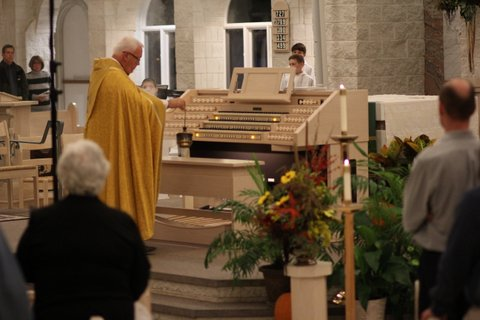 Rev. Fr. Michael King performing the blessing of the organ with incense.