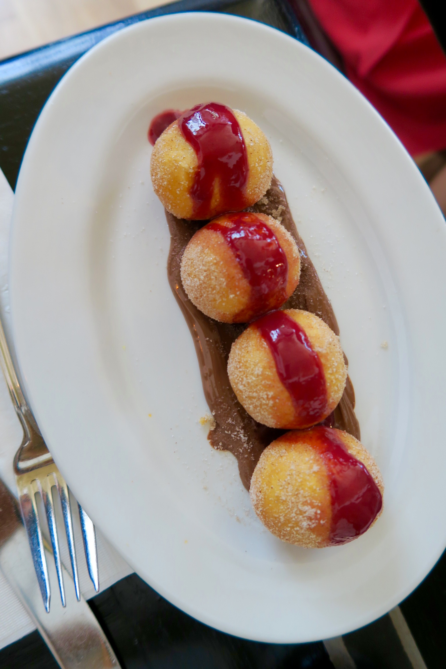 Beignets: nutella and raspberry sauce