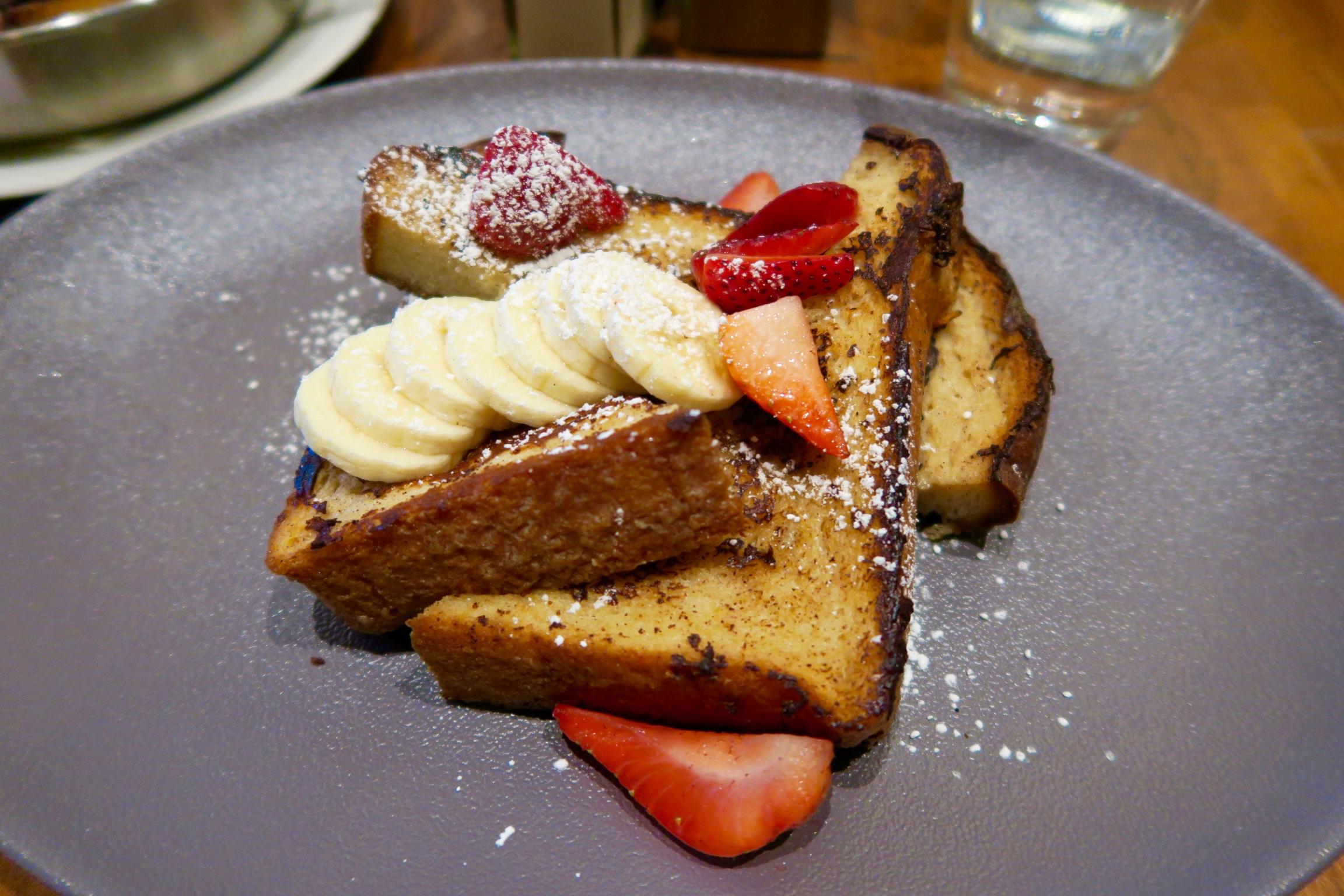 Vanilla Bean French Toast  brioche bread, crème brulée batter, fresh strawberries and bananas